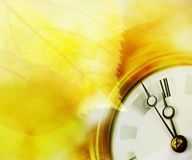 Clock and leaves Royalty Free Stock Image