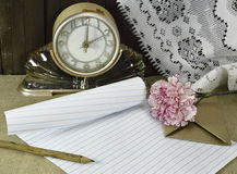 Clock with letter and flower Royalty Free Stock Photo
