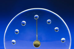 Clock lid with water drop Royalty Free Stock Image