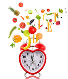 Clock like heart with fruits and vegetables. Royalty Free Stock Photos