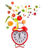 Clock like heart with fruits and vegetables. Stock Photography