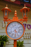 Clock London style. Orange clock London style in the park Stock Image