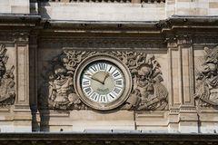 Clock of Louvre Museum Stock Image