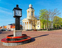Clock and Lutheran Church of St Nicholas in Ventspils Stock Photo