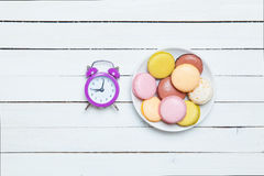 Clock and macaron Stock Image