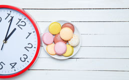 Clock and macaron Stock Photo