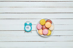 Clock and macaron Stock Images