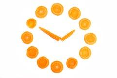 Clock Made of Carrots Stock Photo