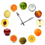 Clock made of different fruit composition set isolated on white Stock Photos