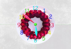 Clock made of a gelly cake showing 6 o'clock Stock Images