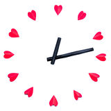 Clock is made paper red hearts Stock Images