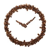 Clock made of roasted coffee beans. Coffee time concept. Isolated stock photos