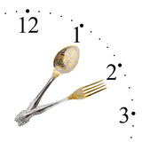 Clock made of spoon and fork Stock Photos