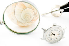Clock with Magnifier and Compass or Time and Space Royalty Free Stock Images