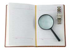 Daily with a clock and a magnifying glass Royalty Free Stock Photography