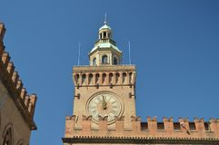 Clock In The Main Facade Of The Communal Palace In Piazza Maggiore In Bologna. Bologna Travel, holidays, architecture. March 31, royalty free stock photo