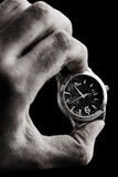 Clock in male hand Royalty Free Stock Image