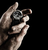 Clock in male hands Stock Photo