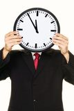Clock manager in front of the head with stress royalty free stock images