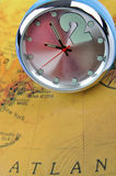 Clock and map. Means time and travel concept, shown as business trip and time across or location change by times Royalty Free Stock Photo
