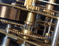 Clock mechanism. Detai of clock mechanism showing cogs and tensioned spring Royalty Free Stock Image