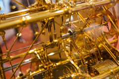 Clock Mechanism. Closeup shot of golden clock gears Stock Photos