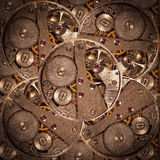 Clock mechanism with gears, background.  Royalty Free Stock Photo
