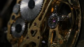 Clock mechanism. Gears. Close up stock footage