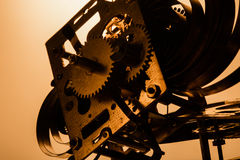 Clock mechanism high resolution. Focus on the central gears. Clock mechanism on gold background. Focus on the central gears. High resolution Stock Image