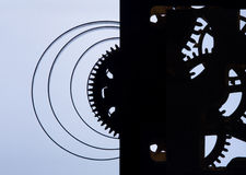 Clock mechanism high resolution. Focus on the central gears. Clock mechanism on grey background. Focus on the central gears. High resolution Royalty Free Stock Images