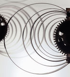 Clock mechanism high resolution. Focus on the central gears. Clock mechanism on grey background. Focus on the central gears. High resolution Stock Image