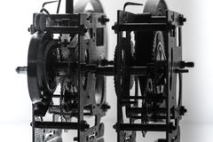 Clock mechanism high resolution. Focus on the central gears. Clock mechanism on grey background. Focus on the central gears. High resolution Stock Photos