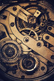 Clock mechanism. Mechanism of pocket wath with grunge texture Royalty Free Stock Photo