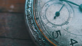 Clock mechanism working, closeup shot with soft focus. Old vintage clock mechanism watch time going fast. Antique clock dial close-up. Vintage pocket watch,A stock footage
