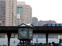 A clock with metro passing by background Royalty Free Stock Photography