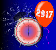 2017 Clock. A 2017 midnight clock with balloon and firework explosion Stock Image