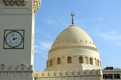 Clock and minaret Royalty Free Stock Images
