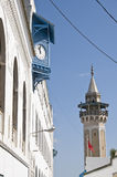 Clock and Minaret. In the Medina of Tunis, capital city of Tunisia Royalty Free Stock Photography