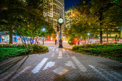 Clock and modern buildings in Uptown Charlotte, North Carolina. Royalty Free Stock Photos