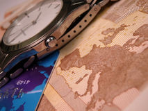 Clock and money. Authority of time above riches Stock Photos