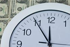 Clock and money Royalty Free Stock Photo