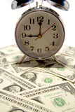 Clock and money Stock Photo