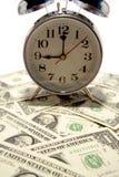 Clock and money Stock Photo