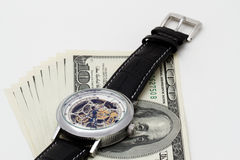 Clock and money close-up. Time is money concept Royalty Free Stock Photos
