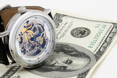 Clock and money close-up. Time is money concept Stock Images