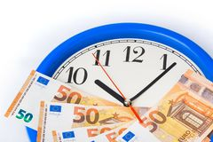 Clock and money euro - business concept stock images
