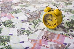 Clock and money Royalty Free Stock Photos