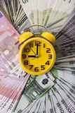 Clock and money Royalty Free Stock Photography