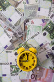Clock and money Stock Images
