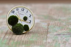 Clock with moss. Macro detail of broken clock. Stopping time concept Royalty Free Stock Photography